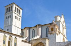 Architectures and religion in Assisi. Italy,Umbria,Assisi, upward view of the St.Francesco basilica facade Royalty Free Stock Photo