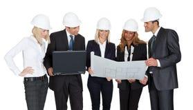Architekt grupa analizuje projekty Zdjęcia Stock