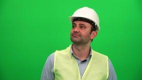 Architekt lub pracownik budowlany Przyglądający Up na zieleń ekranie zbiory