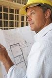 Architekt mit Plänen Stockfotografie