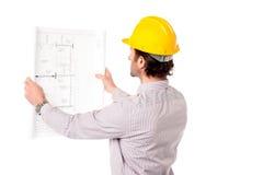 Architekt przegląda budynku plan Zdjęcie Royalty Free