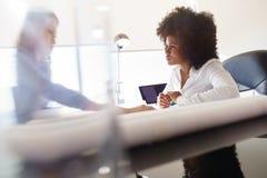 Architekt Women Colleagues Working in Team On Housing Project Lizenzfreies Stockbild