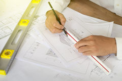 Architektenpunkt am Plan Stockfoto