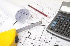 Architekturaufbau mit Hausplänen Lizenzfreies Stockbild