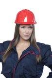 Architetto femminile con il casco di sicurezza isolato Fotografia Stock