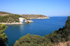 Architiello, a rock arch in the Adriatic Sea, Italy. Along the Baia San Felice in the Italian Adriatic coast at the peninsula of Gargano there is the so-called stock image