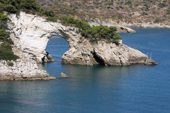 Architiello, a rock arch near Vieste, Italy. Along the Baia San Felice in the Italian Adriatic coast at the peninsula of Gargano there is the so-called Royalty Free Stock Images