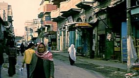 Archival Arab shops of Gaza. Gaza, Palestine, Israel - Circa 1979: Arab shops of the old Gaza city with Palestinian people in typical Keffiyeh, Arab headdress stock video