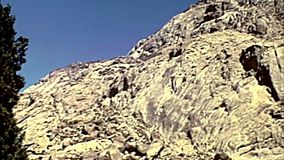 Archival beduin boy of Sinai. Sinai, Egypt - Circa 1979: beduin boy of Sinai on the slopes of Mount Horeb by St. Catherine Monastery walls in the Sinai Peninsula stock video footage
