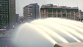 Archival Cairo fountain. Old fountain in Cairo with ancient buildings of the city. Archival from Cairo tower of Egypt in the 1970s stock video footage