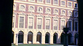 Archival cloister of Hampton Court. Courtyard of Hampton Court Palace, a royal palace in town of East Molesey, beside London city. Fountain Court designed by Sir stock video footage