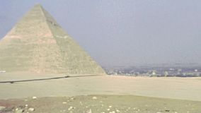 Archival Great Giza Pyramid from Valley Temple. Great Giza Pyramid in Valley Temple of Menkaure of Cairo city. Historical archival of Cairo capital city of Egypt stock footage