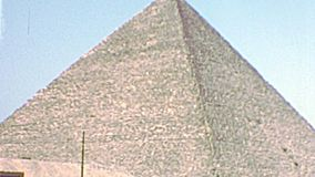 Archival Great Pyramid of Khufu. Great Giza Pyramid or Pyramid of Khufu in Valley Temple of Menkaure in Giza. Historical archival of Cairo capital of Egypt in stock video footage
