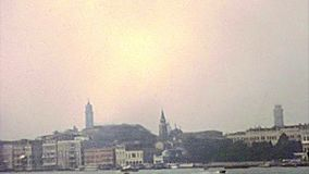 Archival San Giorgio Maggiore basilica. Panorama of Doge`s Palace in San Marco square of Venice with the bell tower. San Giorgio Maggiore basilica and abbey on stock video footage