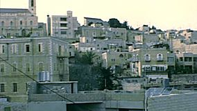 Archival skyline of Bethlehem. Skyline of the town from Church of the Nativity overlook with bell towers of other churches and minarets of the mosques. Archival stock footage