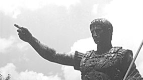 Archival statue of Caesar Augustus in Rome. Close up of the bronze statue of Augustus Roman emperor in Imperial Forums road of Rome city. BW historical archival stock video