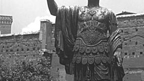 Archival statue of Marco Cocceio Nerva Caesar Augustus in Rome. The bronze cast statue of Marco Cocceio Nerva Caesar Augustus, Roman emperor in Imperial Forums stock footage