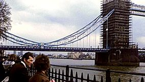 Archival Tower Bridge renewal in London. London, United Kingdom - Circa 1977: Tower Bridge on River Thame. while the bridge was painted red, white and blue to stock footage