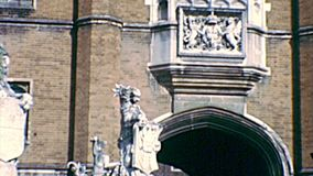 Archival Unicorn Gate of Hampton Court. Close up on statues of Unicorn Gate of Hampton Court Palace, a royal palace in town of East Molesey, Richmond upon the stock footage