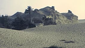 Archival Valley Temple desert dunes stock video