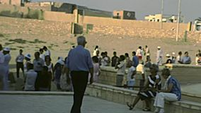 Archival Valley Temple with tourists. Cairo, Egypt, Africa - circa 1982: tourists in vintage dress at the Great Giza Pyramid with camels in Cairo Valley Temple stock footage