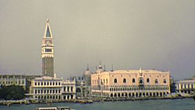 Archival Venice San Marco bell tower. San Marco square of Venice with the bell tower and Doge`s Palace. Sea view by boat tour. Archival of Venezia city of Italy stock footage