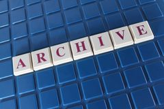 Archive. The word 'archive' spelled out in tiles on a blue blocked background royalty free stock photo