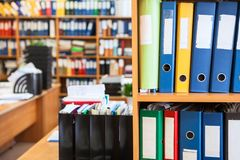Archive department room with a lot of colourful file binders Royalty Free Stock Photo