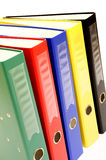 Archiving documents. Row of colorful ring binders for archiving documents against a white background stock image