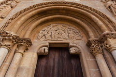 Archivolts in the romanesque style door of San Isidoro Collegiat. Arhivolts, capitals and carved tympanum  detail view of the romanesque style door  called Stock Images