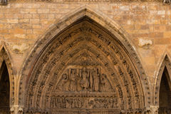 Archivolts and tympanum detail of the main entrance door in the. Tympanum and archivolts detail of the gothic main entrance door in the Cathedral of Leon , Spain Stock Photos