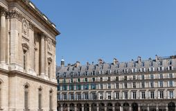 Louvre facade and archs of Rivoli street in Paris stock images
