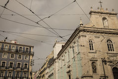 Archtecture, Lisbon, Portugal. A view of some buildings in Lisbon, Portugal. The image was taken looking up. There are some of tram wires visible as well Royalty Free Stock Photo