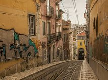Archtecture, Lisbon, Portugal. A view of a street in Lisbon, Portugal. Colorful buildings and a tram rails visible Stock Image