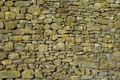 Archtecture texture - stone wall. Old rubble stone wall full frame background close up Stock Image