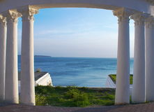 Archway. The colonnade framing pass to the sea Stock Photography