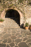 Archway. A stone archway along a pedestrian pathway in historic San Miguel de Allende stock photo