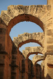 Archway in ancient amphitheater. Arches and walls of ruined antique amphitheater in Tunisia Stock Image