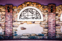 Archway in a brick stone wall Royalty Free Stock Photography