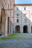 Archway, Columns, Courtyard and Cobblestones in Palace of Pilott Stock Photos