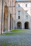 Archway, Columns, Courtyard and Cobblestones in Palace of Pilott Royalty Free Stock Images