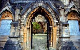 Archway into courtyard, Holyrood Church, Southampton, England Stock Image