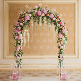 Archway decorated with colorful flowers Stock Image