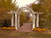 Archway in Fall. And archway on agarden path in the fall Royalty Free Stock Photos