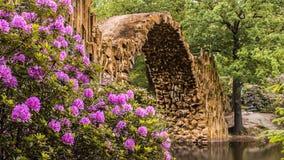 Archway in flower garden Stock Photo