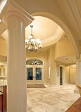 Archway and Foyer in Luxury Home. Elegant home interior with archway and foyer royalty free stock photography