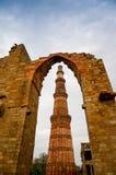 Archway framing the Qutub Minar in Delhi Stock Photo