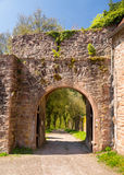 Archway and gate in old castle wall Stock Photo