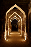 Archway inside Bahrain fort at night Stock Images