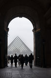 Archway and Louvre pyramid Royalty Free Stock Images